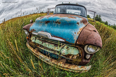 Fisheye Lens View of Abandoned Truck in Field