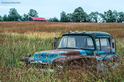 Abandoned truck near agricultural field