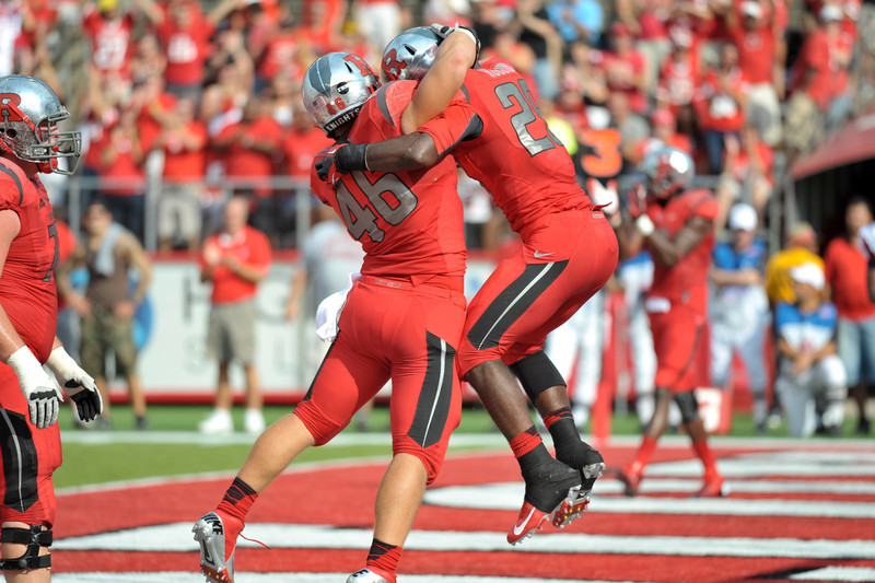 Rutgers' running back, SAVON HUGGINS (28), celebrates after a 1-yard touchdown run against Howard University with MICHAEL BURTON (46).