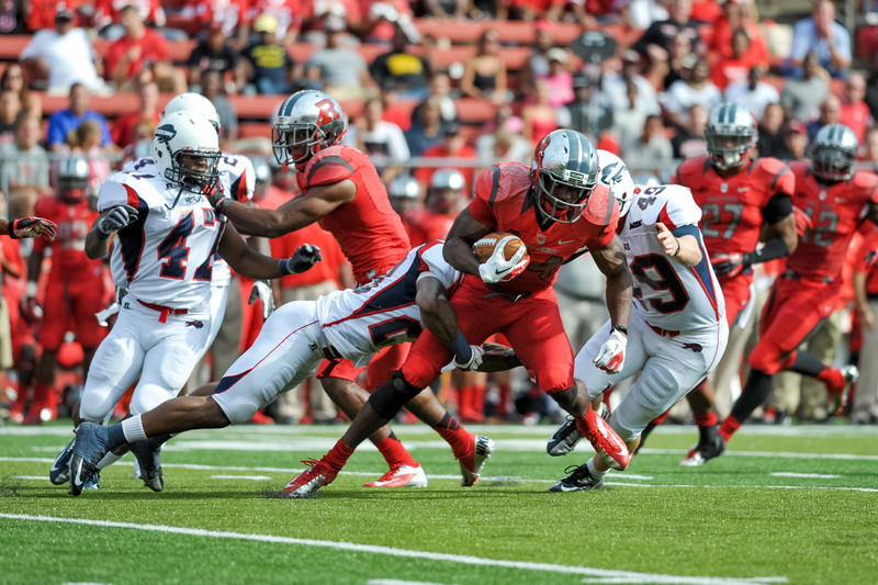 Rutgers' running back, MASON ROBINSON (24), carries the ball against the Howard University defense.