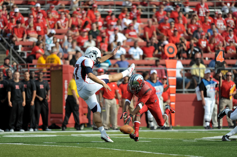 Rutgers' MILES SHULER blocks Howard's JOHN FLECK'S punt attempt.