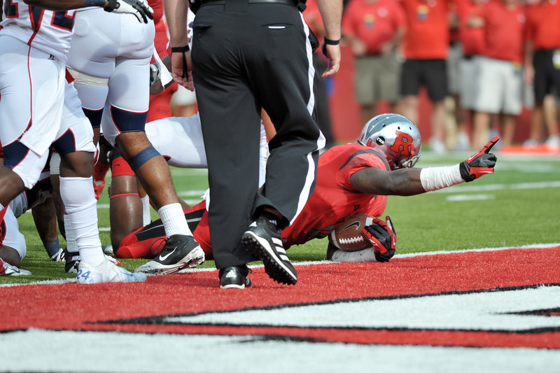 Rutgers' tight end, D.C. JEFFERSON, tries to convince the officials that he crossed the goal line.