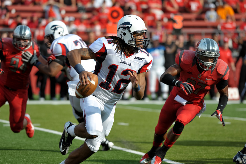 Howard University quarterback, JAMIE CUNNINGHAM (12) rolls out and looks for an open receiver against the Rutgers University defense.