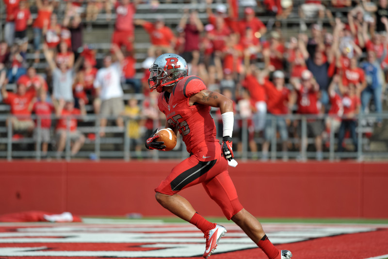 Rutgers' BRANDON JONES returns a blocked punt for a touchdown against Howard University.
