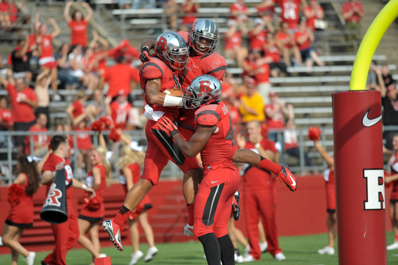 Rutgers' STEVE BEAUHARNAIS (42) and QURON PRATT (7) celebrate with BRANDON JONES after he returns a blocked punt for a touchdown against Howard University.