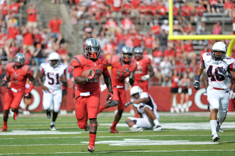 Rutgers' running back, JAWAN JAMISON (23), breaks away from the Howard University defense for a 64-yard run.