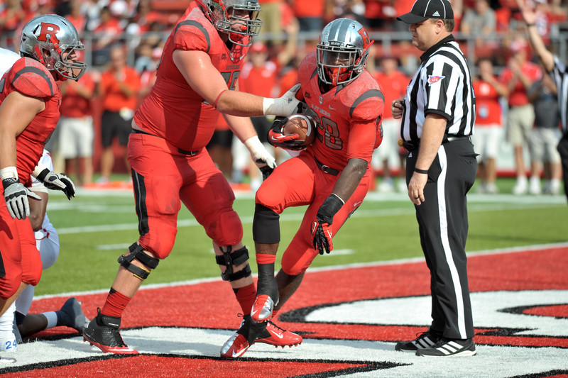 Rutgers' running back, SAVON HUGGINS, celebrates after a 1-yard touchdown run against Howard University.