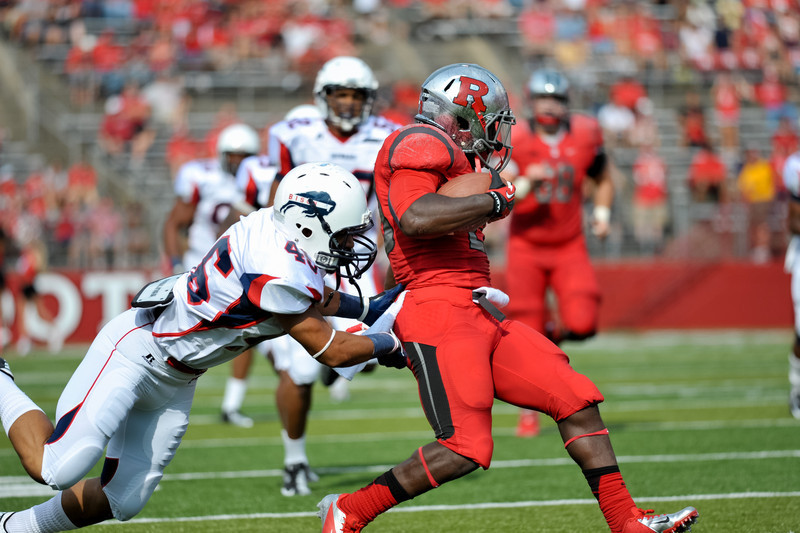 Rutgers' running back, JAWAN JAMISON (23), is tackled by Howard University's JACOB BENNETT (46) at the end of a 64-yard run.