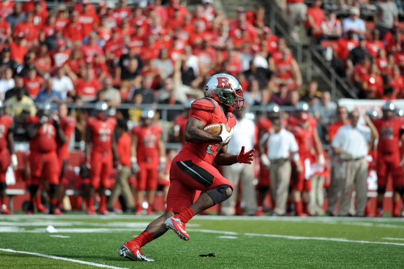 Rutgers' running back, MASON ROBINSON, carries the ball against the Howard University defense.