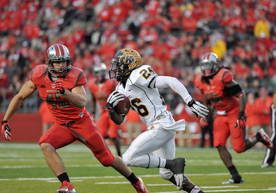 Rutgers linebackers, KEVIN SNYDER (45) and KHASEEM GREENE (20) try to chase down Kent State's