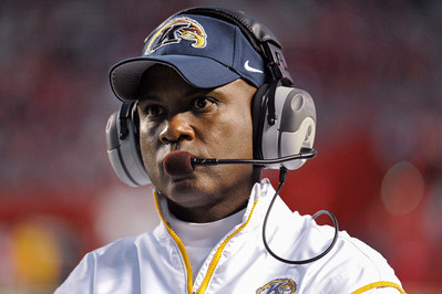 Kent State head coach, DARRELL HAZELL, walks the sideline in the fourth quarter as his team nears an upset of Rutgers.