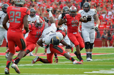 Kent State running back, TRAYION DURHAM (34), gets upended by Rutgers linebacker, KHASEEM GREENE.