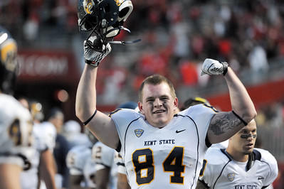 Kent State tight end, KYLE PATTON, celebrates on the sideline in the fourth quarter as his team grows closer to pulling off the upset of Rutgers.