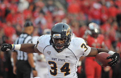 Kent State runningback, TRAYION DURHAM (34), celebrates after a touchdown run against Rutgers.