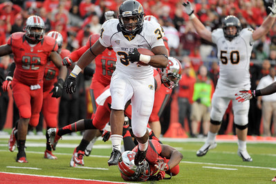 Kent State runningback, TRAYION DURHAM (34), rushed for 131 yards and this touchdown score against Rutgers.