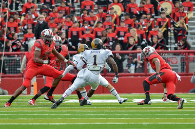 Kent State running back, DRI ARCHER (1) cuts up field against the Rutgers University defense.