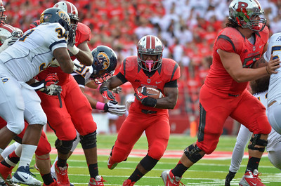 Rutgers running back, JAWAN JAMISON, finds a hole to rush through against Kent State.