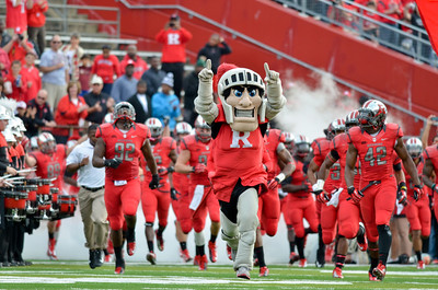 The Rutgers football team is led onto the field by the school's mascot, the Scarlet Knight.