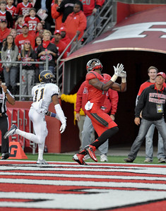 Rutgers wide receiver, BRANDON COLEMAN (17), concentrates on catching an incoming endzone pass against Kent State defensive back, NORMAN WOLFE JR. (11).