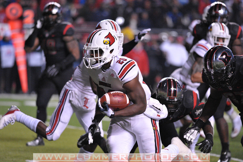 Louisville running back, CORVIN LAMB (20), rushes the ball in the first half of the de facto Big East championship game against Rutgers at Highpoint Solutions Stadium in Piscataway, New Jersey.