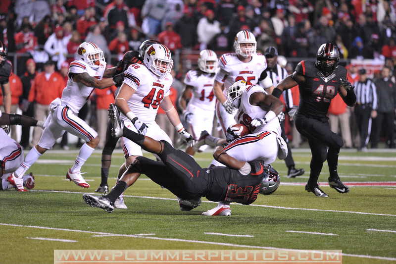 Rutgers linebacker, JAMAL MERRELL (37), takes down a Louisville running back in the de facto Big East championship game at Highpoint Solutions Stadium in Piscataway, New Jersey.