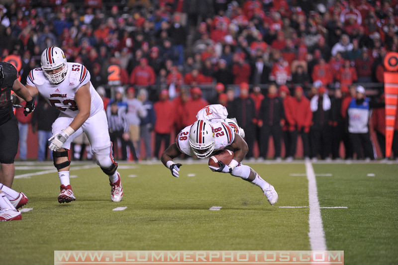 Louisville running back, JEREMY RIGHT (28), stumbles as he rushes the ball in the second half of the de facto Big East championship game against Rutgers at Highpoint Solutions Stadium in Piscataway, New Jersey.