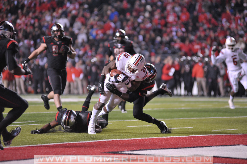Louisville running back, JEREMY RIGHT (28), rushes the ball in the second half of the de facto Big East championship game against Rutgers at Highpoint Solutions Stadium in Piscataway, New Jersey.