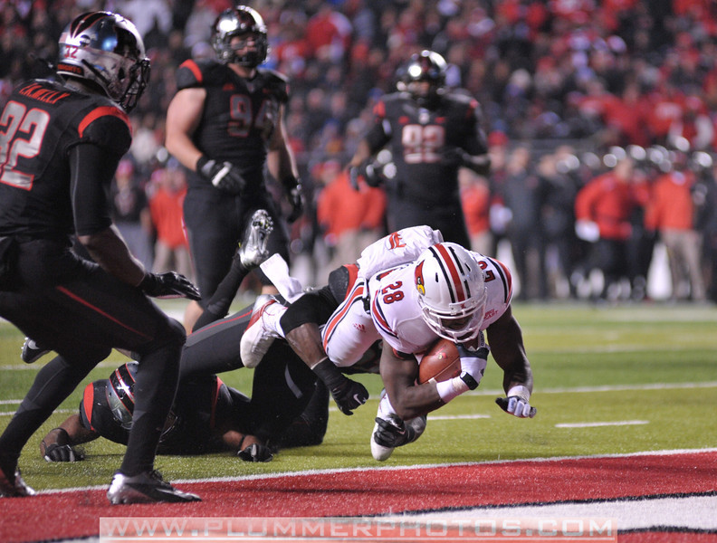 Louisville running back, JEREMY RIGHT (28), rushes the ball for a touchdown in the second half of the de facto Big East championship game against Rutgers at Highpoint Solutions Stadium in Piscataway, New Jersey.