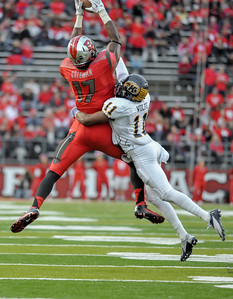 Rutgers wide receiver, BRANDON COLEMAN (17), catches a pass over Kent State defensive back, NORMAN WOLFE JR. (11).