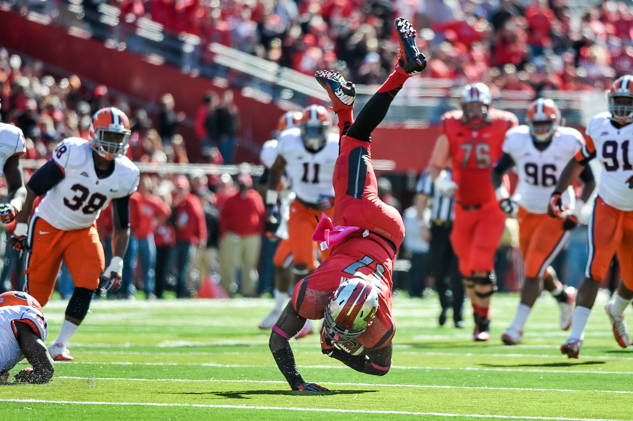 Rutgers wide receiver, BRANDON COLEMAN (17), gets tripped up after making a catch against Syrcause University.