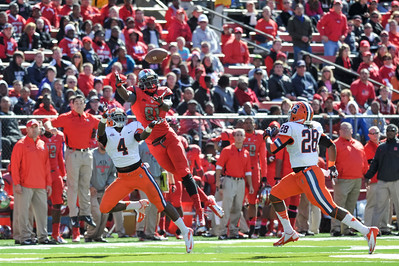 Rutgers wide receiver, MARK HARRISON (81) stretches out for a pass against Syracuse defenders, BRANDON REDDISH (4) and JEREMI WILKES (24).