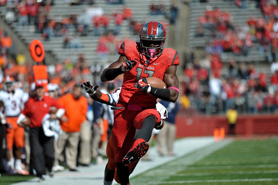Rutgers wide receiver, BRANDON COLEMAN (17), looks to outrun Syracuse University defenseive back, BRANDON REDDISH (4), after a catch.