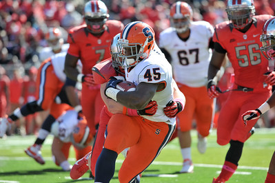 Syracuse running back, JEROME SMITH (45), tries to shake off a Rutgers defender as he rushes the ball.