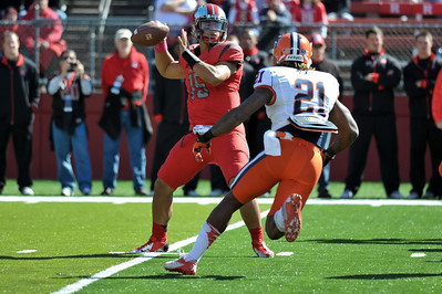 Rutgers quarterback, GARY NOVA (15) looks to pass as Syracuse strong safety, SHAMARKO THOMAS (21), closes in on him.