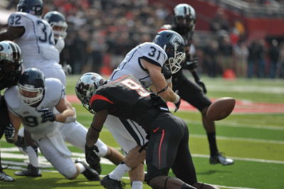 Rutgers defensive back, TEJAY JOHNSON (9), forces a fumble out of UConn wide receiver NICK WILLIAMS (31).