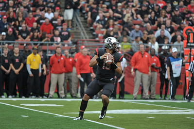 Rutgers' quarterback, GARY NOVA sets his feet for a throw downfield against UConn.
