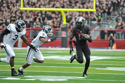 Rutgers wide receiver, BRANDON COLEMAN (17), looks to outrun the UConn defense after a catch.