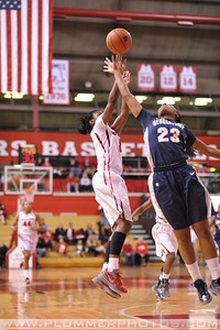 Rutgers guard, ERICA WHEELER (3), pulls up for a jump shot against Georgetown in a game at the Rutgers Athletic Center in Piscataway, New Jersey.