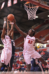 Rutgers forward, CHELSEY LEE (50), battles for a rebound against Georgetown in a game at the Rutgers Athletic Center in Piscataway, New Jersey.