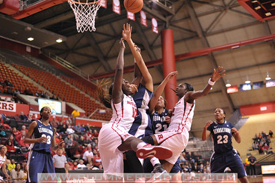 Rutgers forwards, CHELSEY LEE (50) and KAHLEAH COPPER, battle for a rebound against Georgetown in a game at the Rutgers Athletic Center in Piscataway, New Jersey.