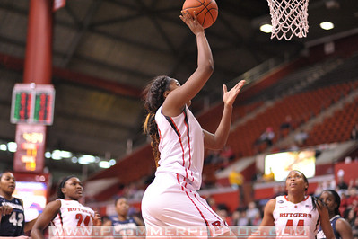 Rutgers forward, MONIQUE OLIVER (34), drives to the basket against Georgetown in a game at the Rutgers Athletic Center in Piscataway, New Jersey.