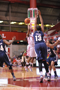 Rutgers guard, SHAKEENAH RICHARDSON (24), pulls up for a jump shot against Georgetown in a game at the Rutgers Athletic Center in Piscataway, New Jersey.
