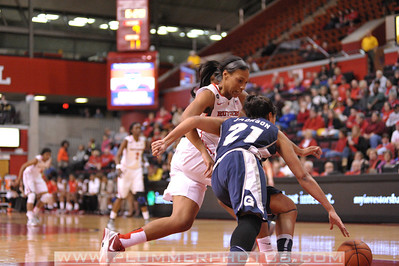 Rutgers guard, BETNIJAH LANEY (44), pressures a Georgetown ball handler in a game at the Rutgers Athletic Center in Piscataway, New Jersey.