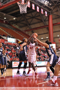 Rutgers forward, CHELSEY LEE (52), drives to the basket against Georgetown in a game at the Rutgers Athletic Center in Piscataway, New Jersey.