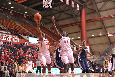 Rutgers forwards, MONIQUE OLIVER (34) and CHELSEY LEE (52), reach for a pass against Georgetown in a game at the Rutgers Athletic Center in Piscataway, New Jersey.
