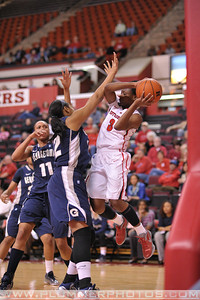 Rutgers guard, ERICA WHEELER (3), drives to the basket against Georgetown in a game at the Rutgers Athletic Center in Piscataway, New Jersey.