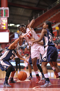 Rutgers forward, MONIQUE OLIVER (34), battles for a loose ball against Georgetown in a game at the Rutgers Athletic Center in Piscataway, New Jersey.