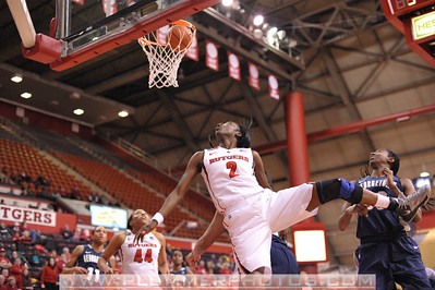 Rutgers guard, KAHLEAH COPPER (2),  watches the ball after a drive to the basket against Georgetown in a game at the Rutgers Athletic Center in Piscataway, New Jersey.