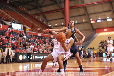 Rutgers forward, BETNIJAH LANEY (44), is fouled as she drives to the basket against Georgetown in a game at the Rutgers Athletic Center in Piscataway, New Jersey.