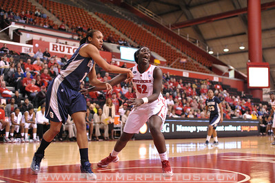 Rutgers forward, CHELSEY LEE (50), battles for position in the post against Georgetown in a game at the Rutgers Athletic Center in Piscataway, New Jersey.